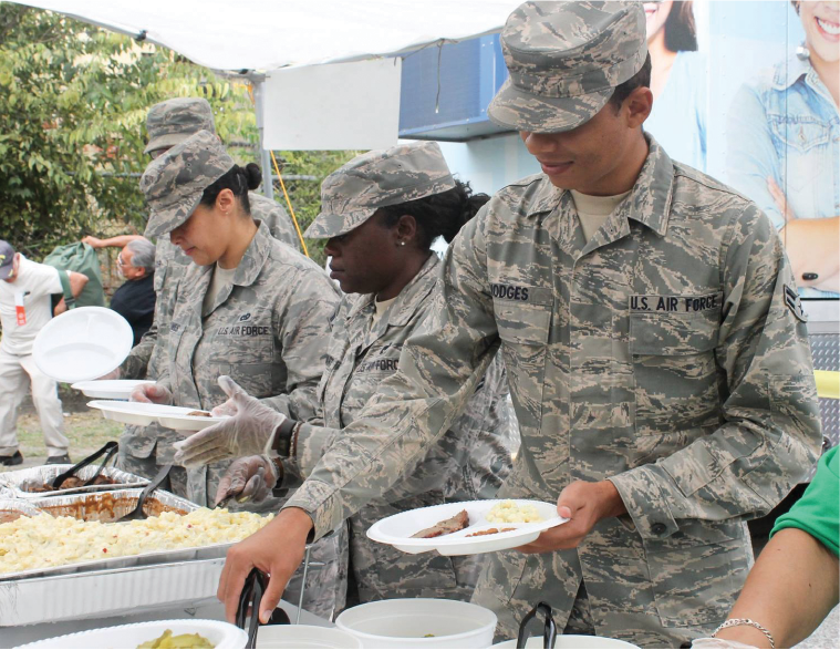 Lackland Air Force Base volunteers serve food to veterans at AGIF's 2018 Stand Down for Veterans.