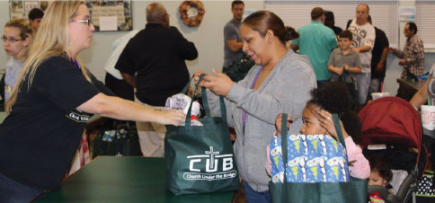 Faithful volunteers annually build and pass out hundreds of Christmas Bags with cold weather gear, food, hygiene items and Christmas presents to provide for those who may otherwise not have a Christmas.