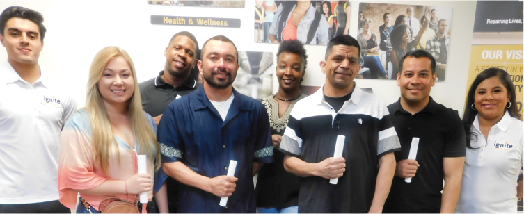 Recent graduates of Ignite's RESET Exoffender Program gather, celebrating newfound purpose.