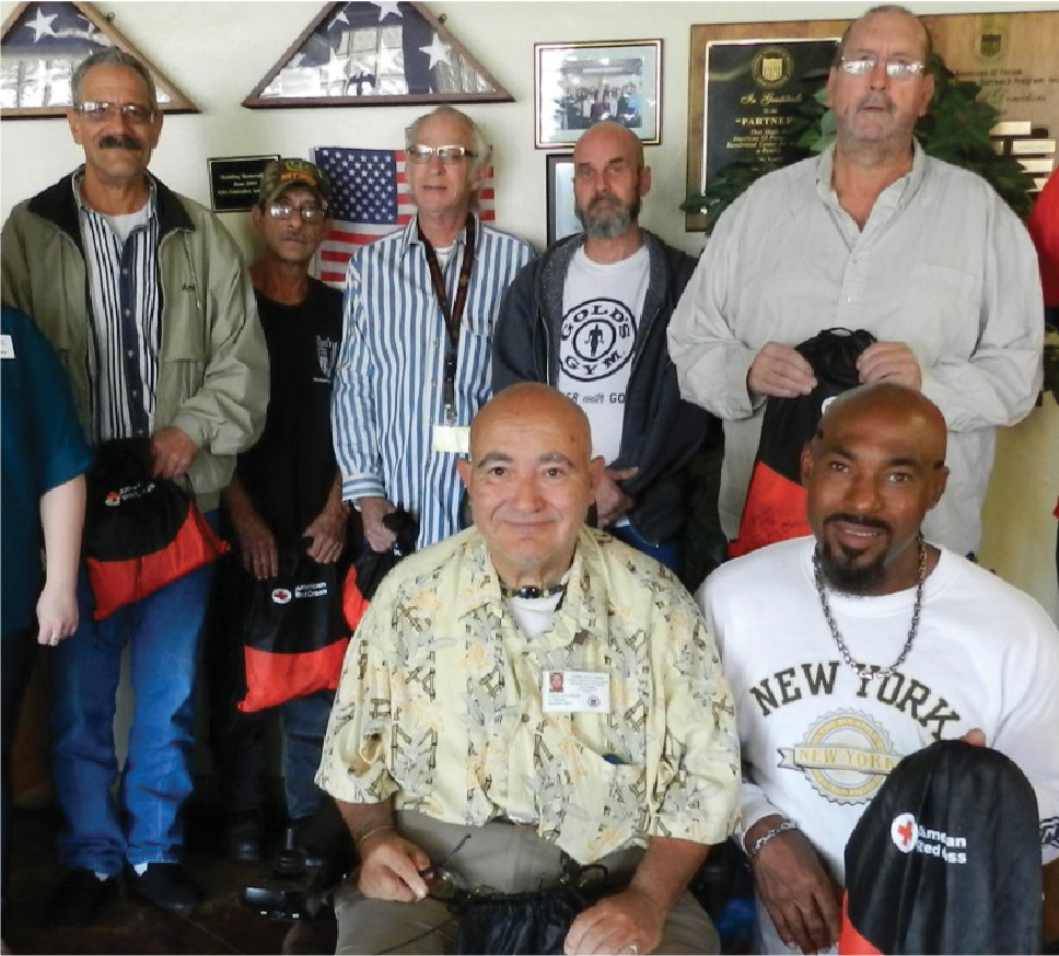 Veteran residents gather at AGIF's Residential Center for Veterans (RCV). The RCV provides 60 single room occupancy apartments and 80 transitional housing beds for veterans in San Antonio.
